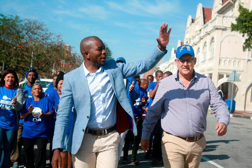 Democratic Alliance leader Mmusi Maimane (left) and the mayoral candidate for Nelson Mandela Bay, Athol Trollip wave to their suppoters during their election campaign in Port Elizabeth in South Africa. Photo: Reuters