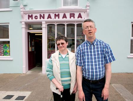 Siblings Dolores and Thomas McNamara outside their shop. Photo: Brian Gavin/Press 22