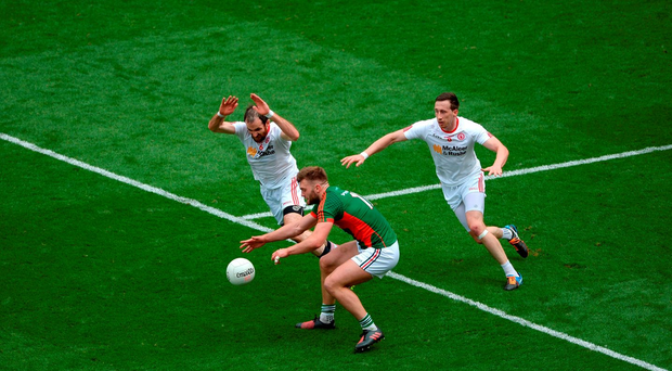 Aidan O'Shea of Mayo in action against Justin McMahon, left, and Colm Cavanagh of Tyrone