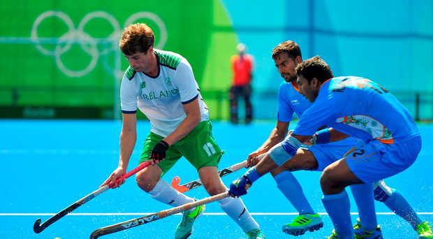 John Jermyn of Ireland in action against Danish Mujtaba, centre, and Raghunath Vokkaliga of India