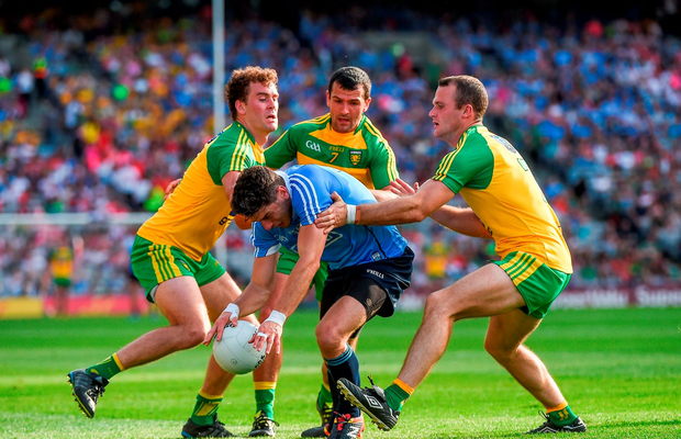 Bernard Brogan of Dublin is tackled by Donegal players Eamonn McGee, left, Frank McGlynn,7, and Neil McGee