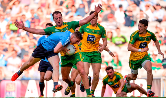 John Small of Dublin in action against Michael Murphy of Donegal