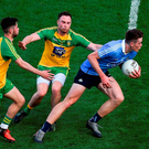 Brian Fenton of Dublin in action against Ryan McHugh and Martin McElhinney of Donegal. Photo: Daire Brennan/Sportsfile
