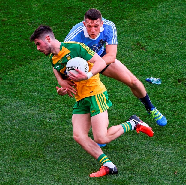Ryan McHugh of Donegal in action against Darren Daly of Dublin. Photo: Daire Brennan/Sportsfile