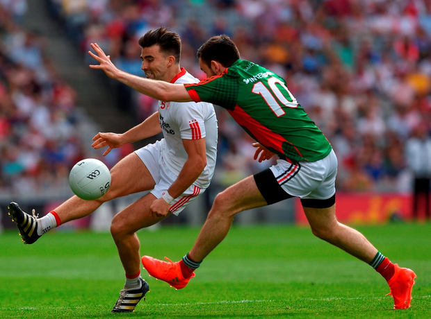 Tiernan McCann of Tyrone in action against Kevin McLoughlin of Mayo. Photo by Ray McManus/Sportsfile