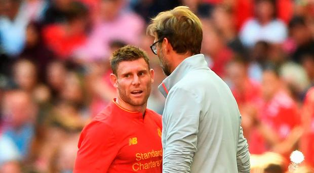 James Milner of Liverpool talks with Jurgen Klopp, Manager of Liverpool as he is substituted during the International Champions Cup match between Liverpool and Barcelona