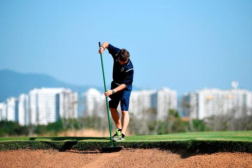 Finishing touches are put to the course for the Games, where designers 'faced the challenge of building a layout worthy of the Olympics, but which could later become a municipal facility'. Photo: Getty Images