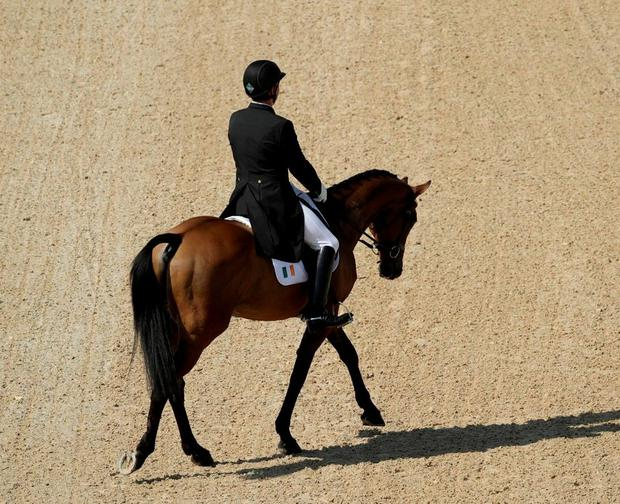 Padraig McCarthy of Ireland on 'Simon Porloe' in the dressage competition. (AP Photo/John Locher)