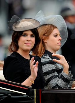 FASHION FOIBLES: Sarah Ferguson and Prince Andrew's two daughters, Princesses Eugenie and Beatrice. Photo by Charlie Crowhurst/Getty Images for Ascot Racecourse