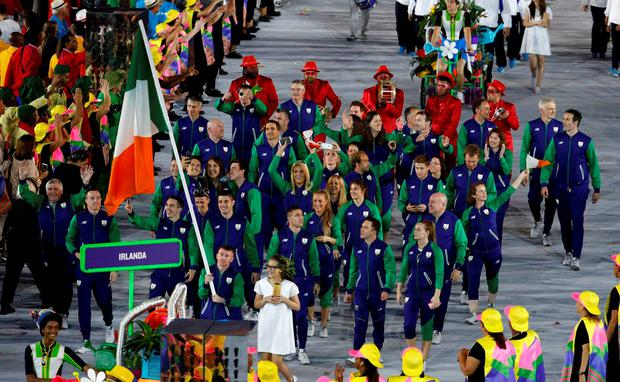 2016 Rio Olympics - Opening ceremony - Maracana - Rio de Janeiro, Brazil - 05/08/2016. Flagbearer Patrick Barnes (IRL) of Ireland leads his contingent during the opening ceremony. REUTERS/Stoyan Nenov FOR EDITORIAL USE ONLY. NOT FOR SALE FOR MARKETING OR ADVERTISING CAMPAIGNS.