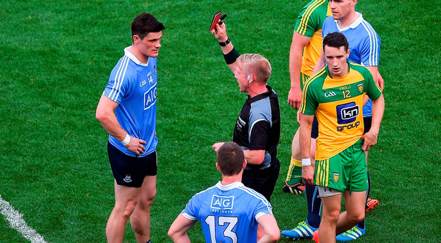 Diarmuid Connolly of Dublin receives a red card from referee Ciarán Branagan during the GAA Football All-Ireland Senior Championship Quarter-Final match between Dublin and Donegal at Croke Park