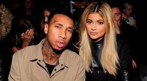 Tyga (L) and Kylie Jenner