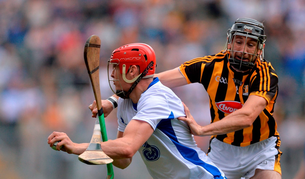 Tadhg de Búrca of Waterford in action against Conor Fogarty of Kilkenny