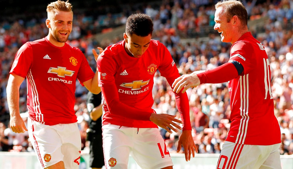 Manchester United's Jesse Lingard celebrates with Wayne Rooney and Luke Shaw after scoring their first goal . Action Images via Reuters / John Sibley
