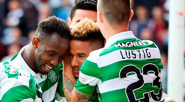 Celtic's Scott Sinclair (centre right) is congratulated by his team mates