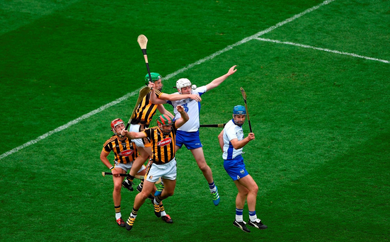 Shane Bennett, left, and Michael Walsh of Waterford in action against Cillian Buckley, Joey Holden, and Kieran Joyce of Kilkenny