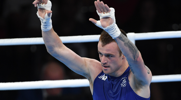 Steven Donnelly of Ireland celebrates after defeating Zohir Kedache of Algeria in their Welterweight preliminary round of 32 bout in the Riocentro Pavillion 6 Arena Cardy/Sportsfile