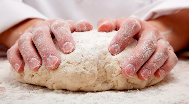 Kneading bread dough. Photo posed by model