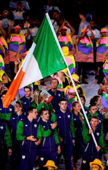 Flag-bearer Paddy Barnes leads the Irish team into the Maracana Stadium on Friday for the Olympics' opening ceremony. Photo: Ramsey Cardy/Sportsfile