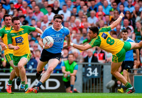 Dublin's Diarmuid Connolly ghosts through the Donegal defence before shooting narrowly wide. Photo by Ray McManus/Sportsfile