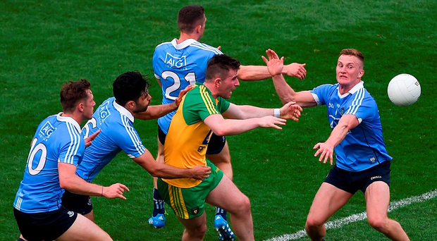 6 August 2016; Patrick McBrearty of Donegal in action against Dublin players, left to right, Paul Flynn, Cian O'Sullivan, Darren Daly, and Ciarán Kilkenny during the GAA Football All-Ireland Senior Championship Quarter-Final match between Dublin and Donegal at Croke Park in Dublin. Photo by Daire Brennan/Sportsfile