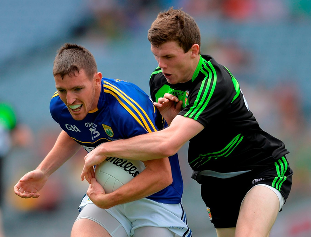 Kerry's Niall O'Shea resists a tackle from Eoin O'Donoghue. Photo by Eóin Noonan/Sportsfile