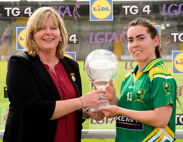 LGFA President Marie Hickey presents Sarah Houlihan of Kerry with her player of the match trophy. Photo by Matt Browne/Sportsfile