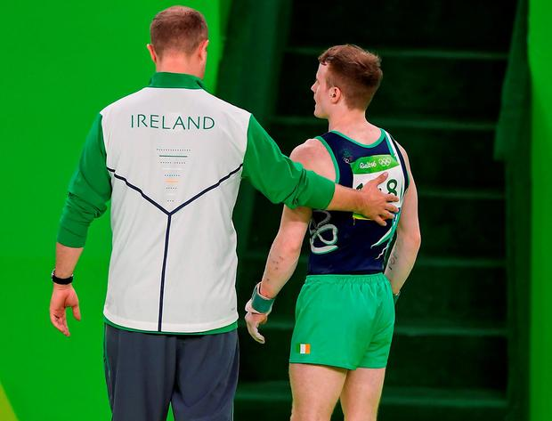 Kieran Behan of Ireland is helped from the field of play after suffering a suspected dislocated left knee. Photo by Brendan Moran/Sportsfile
