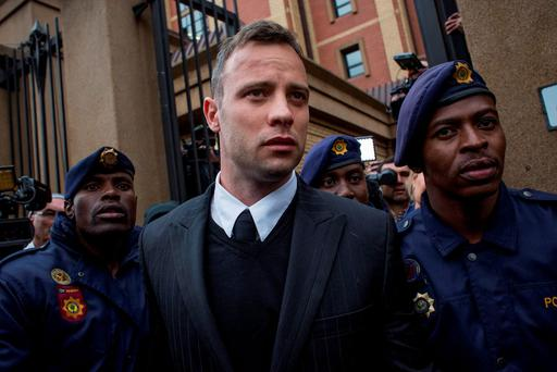 Pistorius claims cuts to wrists are from falling out of his bed