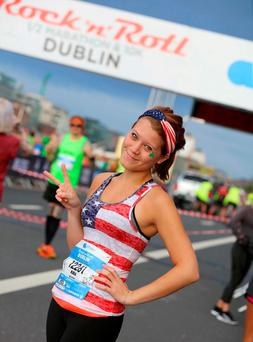 The sun shone on the capital as runners, including Kira McCarthy from Washington DC, took part in the Rock 'n' Roll Dublin Half Marathon yesterday. Photo: Marc O'Sullivan
