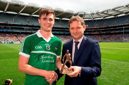 Brian Ryan is presented with the Electric Ireland Man of the Match by Jim Dollard. Photo by Ray McManus/Sportsfile