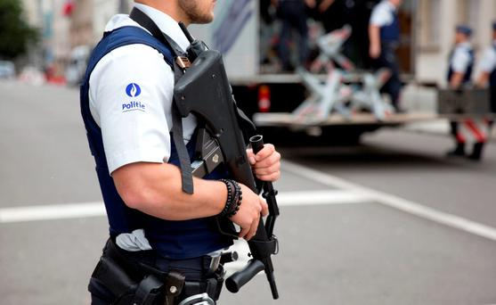 Police secure an area in front of the Belgian Prime Minister's office, after a man attacked two police officers with a machete near the police headquarters in Charleroi on Saturday. Photo: AP Photo/Virginia Mayo
