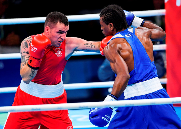 Ireland's David Oliver Joyce exchanges punches with Andrique Allisop of Seychelles during their lightweight bout at the Rio Olympics last night. Photo: Ramsey Cardy/Sportsfile