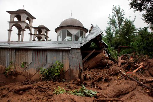 A house destroyed by a mudslide stands in Xaltepec, on the mountainous north of Puebla state, Mexico (AP Photo/Pablo Spencer)