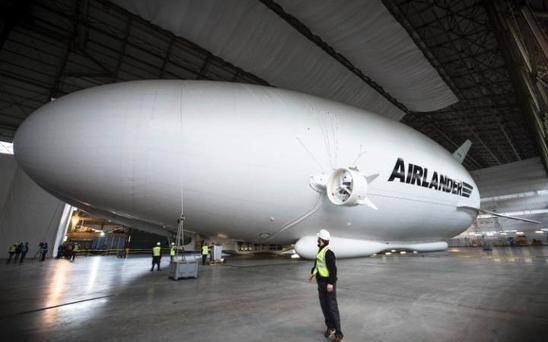The Airlander 10, billed as the world's largest aircraft - a cross between a plane, an airship and a helicopter is the length of a football pitch and the height of six double-decker buses Credit: John Nguyen/JNVisuals