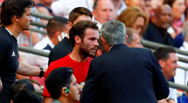 Manchester United manager Jose Mourinho speaks with Juan Mata after he was substituted Reuters / Eddie Keogh