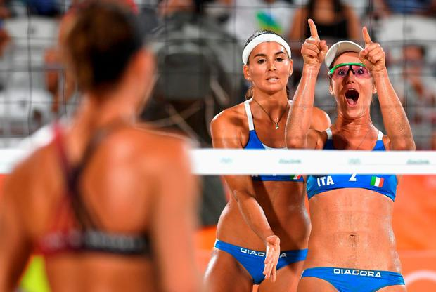Laura Giombini of Italy (R) reacts during the Women's Beach Volleyball preliminary round Pool D match against Jamie Lynn Broder and Kristina Valjas of Canada on Day 2 of the Rio 2016 Olympic Games at the Beach Volleyball Arena on August 7, 2016 in Rio de Janeiro, Brazil. (Photo by Shaun Botterill/Getty Images)
