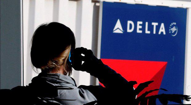 A passenger talks on her phone at a Delta Airlines gate. File picture