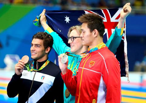 Mack Horton (AUS) of Australia, Sun Yang (CHN) of China (PRC) and Gabriele Detti (ITA) of Italy pose with their medals. REUTERS/Michael Dalder