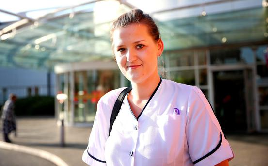 Staff nurse Dominica Orawrska pictured outside the entrance to St James Hospital.. Picture; Gerry Mooney