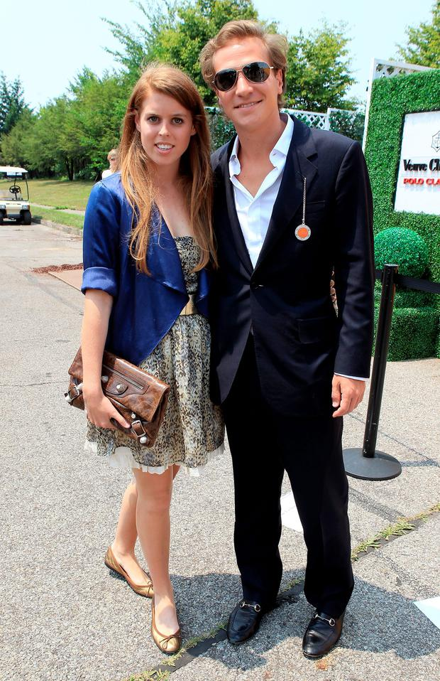 Princess Beatrice and Dave Clark pose for a photograph as they attend the 2010 Veuve Clicquot Manhatten Polo Classic on Governor's Island on June 27, 2010 in New York