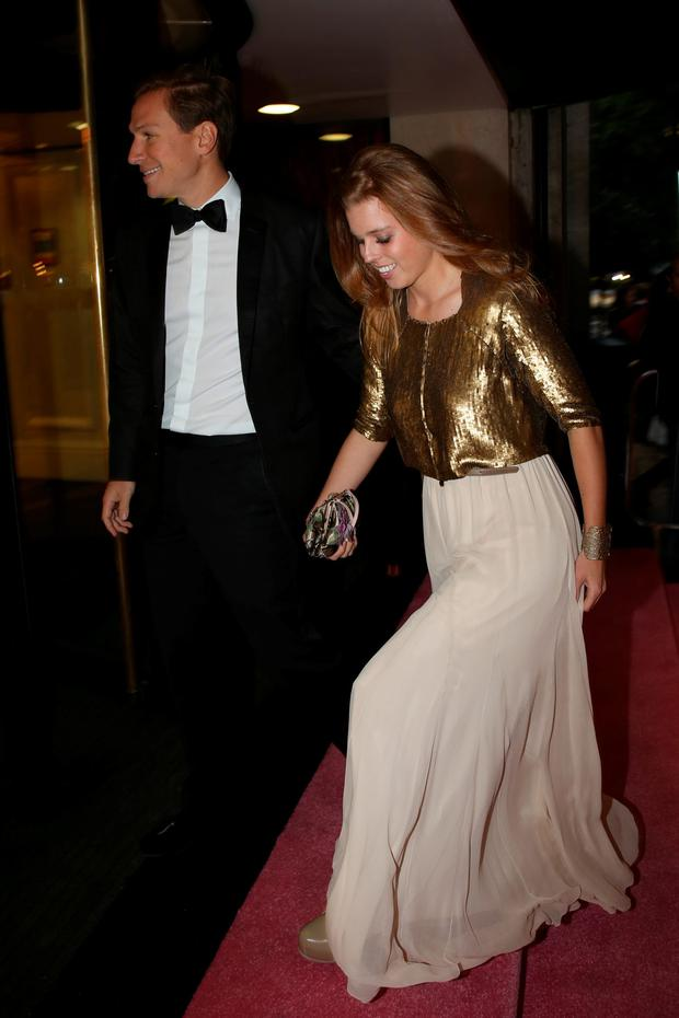 Princess Beatrice of York and Dave Clark pose at the Boodles Boxing Ball 2013 on September 21, 2013 at the Grosvenor House in London,England. (Photo by Dominic O'Neill/Boodles Boxing Ball Committee via Getty Images)