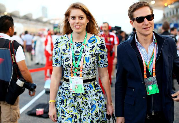 Princess Beatrice and David Clark walk across the grid during the Bahrain Formula One Grand Prix at Bahrain International Circuit on April 19, 2015 in Bahrain, Bahrain. (Photo by Mark Thompson/Getty Images)