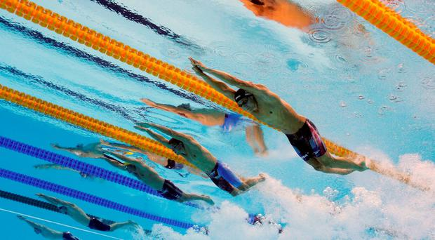 Caeleb Dressell of the United States, Andrey Grechin of Russia, James Roberts of Australia, Santo Condorelli of Canada and Glenn Surgeloose of Belgium compete in the Final of the Men's 4 x 100m Freestyle Relay last night