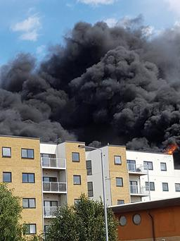 Scene of a fire at a new block of flats near to a KFC restaurant on Erith High Street, Bexley, south east London. P/A Photo.