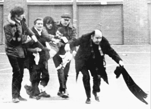 The iconic picture of then Fr Edward Daly leading a group of people as they carry Jackie Duddy, who later died, on a street in Derry on Bloody Sunday