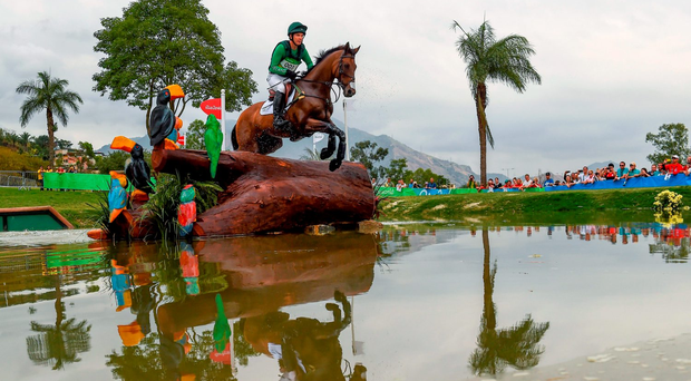Padraig McCarthy of Ireland on Simon Porloe in action during the Eventing Team Cross Country