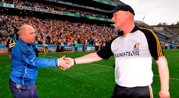 'We'll meet again' – Waterford's Derek McGrath shakes hands with Kilkenny manager Brian Cody on Sunday. Photo: Piaras Ó Mídheach/Sportsfile