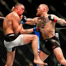 Conor McGregor lands a blow on Nate Diaz Photo: AP Photo/Eric Jamison