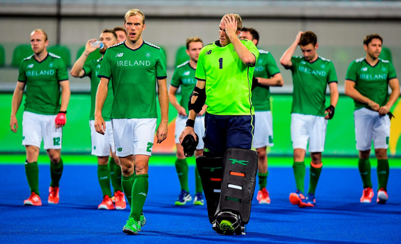 Ireland players including Conor Harte, second from left, and brother David Harte leave the pitch after their Pool B defeat by the Netherlands. Photo by Brendan Moran/Sportsfile